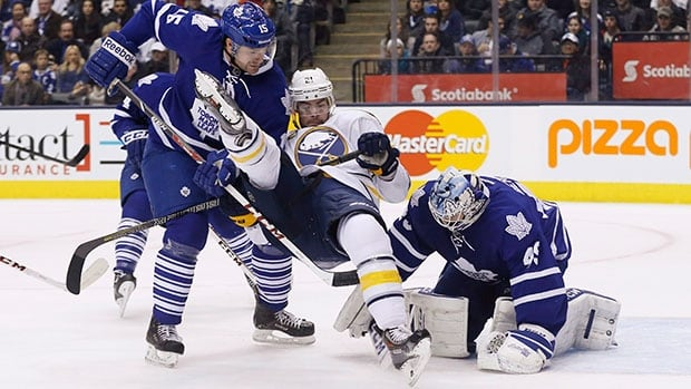 Injuries have sidelined Toronto Maple Leafs goalie Jonathan Bernier, right, and defenceman Paul Ranger (15) for an extended period of time.