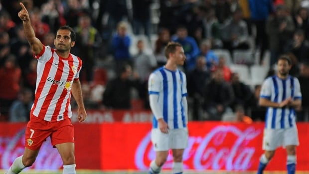Almeria's midfielder Verza celebrates after scoring against Real Sociedad Monday.