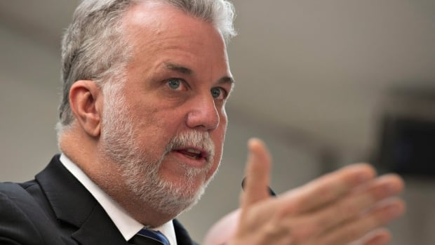 Quebec Liberal Party Leader Philippe Couillard responds to reporters questions at a news conference Tuesday in Trois-Rivières, Que.