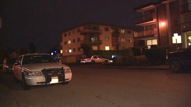 Police cars are seen parked outside an apartment complex in the 5100 block of Irving Street in Burnaby, B.C. The death of a woman who was found injured in one of the units Monday night is being considered suspicious.