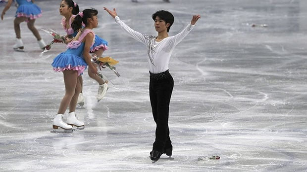 Tatsuki Machida takes a bow after his performance in the men's short program at the figure skating worlds in Saitama, Japan.