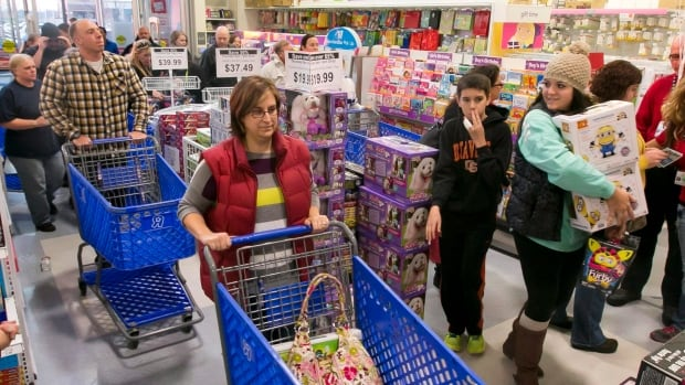 Shoppers snap up bargains in Toys 'R' Us store  on American Thanksgiving Day in Meridian, Idaho.  The rest of the holiday season was not so strong for the retailer and same-store sales fell by 3.5 per cent.