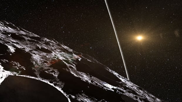 This artist's impression shows how the rings might look from close to the surface of Chariklo. They are 1,000 times closer than the moon is to Earth, but are each just a few kilometres wide.