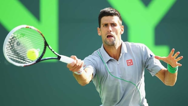 Novak Djokovic of Serbia returns a shot against Andy Murray of Great Britain during their match at the Sony Open in Key Biscayne, Fla., Wednesday.