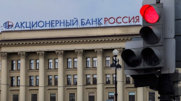 The head office of Bank Rossiya in St. Petersburg, Russia, Friday, March 21, 2014. Visa and MasterCard stopped providing services to the bank after sanctions  were laid against the bank's owner, Yuri Kovalchuk, considered to be Russian President Vladimir Putin's longtime friend and banker.