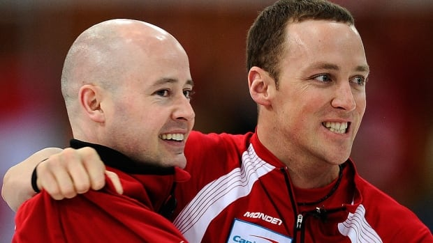 Canadian skip Kevin Koe, left, and lead Nolan Thiessen are seen here celebrating their victory over Norway in the final at the 2010 men's world curling championship. Thiessen won't be part of Koe's rink next season.