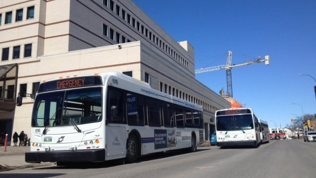 "Buses with ""Emergency"" signs housed people who were forced to leave the Health Sciences Centre Thursday afternoon after a chemical spill forced the evacuation of the Thorlakson Building."