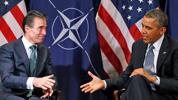 Strengthening a tattered alliance? U.S. President Barack Obama greets NATO Secretary-General Anders Fogh Rasmussen in Brussels on Wednesday. Earlier in the day, Obama visited the Flanders Field American war cemetery.