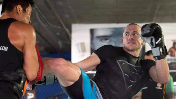 Georges St-Pierre remained in training after vacating the title in December and plans to return to MMA at some time.