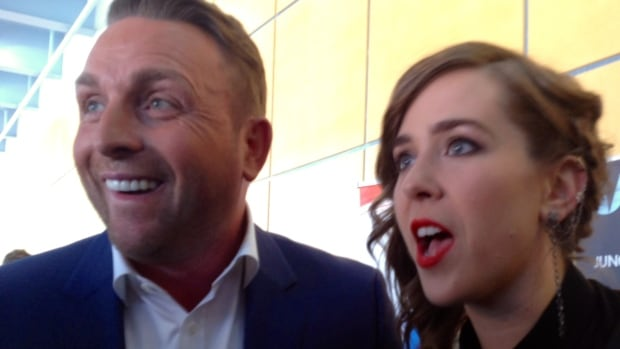 Juno co-hosts Johnny Reid and Serena Ryder ham it up with reporters at the MTS Centre in Winnipeg Friday.