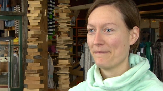 Riva Mackie, who owns Riva's Eco Store, says she is having trouble paying rent for her Inglewood business after losing inventory in last year's flood and a harsh winter that has kept away shoppers.