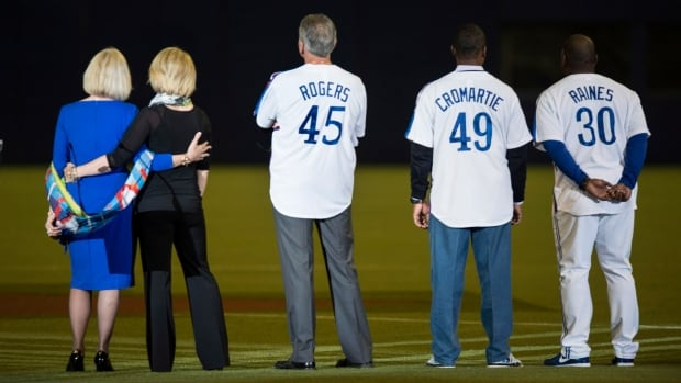 Left to right, Sandy Carter, wife of former Montreal Expos Gary Carter, her daughter Kiimy, former Expos Steve Roger, Warren Cromartie and Tim Raines watch a video tribute to Gary Carter before Friday's exhibition game at the Olympic Stadium in Montreal.