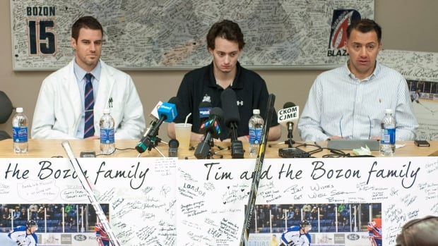 Kootenay Ice forward and Montreal Canadiens prospect Tim Bozon speaking to media before his expected release from a Saskatoon hospital earlier this year. At left is neurologist Dr. Gary Hunter, and at right Tim's father Philippe Bozon.