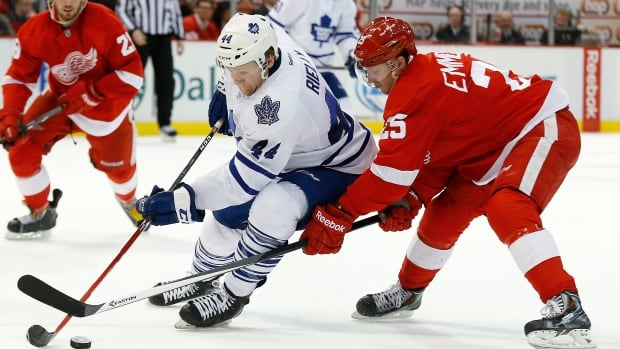 Detroit Red Wings' Cory Emmerton, right, and Toronto Maple Leafs' Morgan Rielly in Detroit, Tuesday, March 18, 2014.