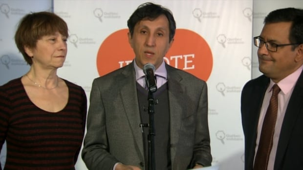 Quebec Solidaire candidate Amir Khadir, flanked by party spokespeople Françoise David and Andrés Fontecilla, speaks at a press conference on Saturday morning.