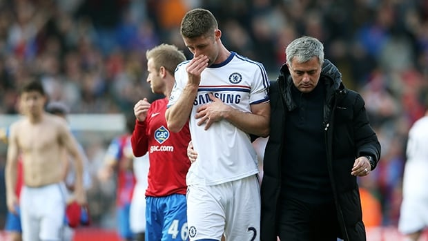 Chelsea manager Jose Mourinho consoles a dejected Gary Cahill following the loss to Crystal Palace at Selhurst Park on March 29, 2014 in London, England.