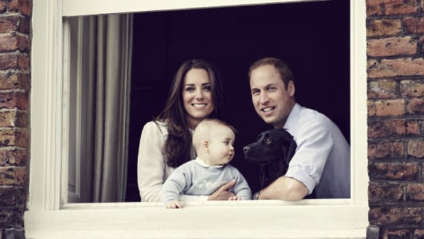 Prince William and Kate Middleton, the Duke and Duchess of Cambridge pose with their son, Prince George for an official family portrait taken at Kensington Palace on March 18, 2014.