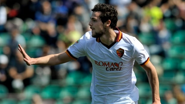 Roma's Mattia Destro celebrates after scoring against Sassuolo, at Reggio Emilia's Mapei stadium, Italy, Sunday, March 30, 2014.