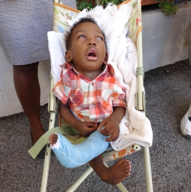Young girl at Team Broken Earth clinic