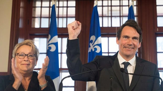 Parti Québécois leader Pauline Marois looks on as Pierre Karl Péladeau expresses his hopes for an independent Quebec during a press in Saint Jérôme, Que.