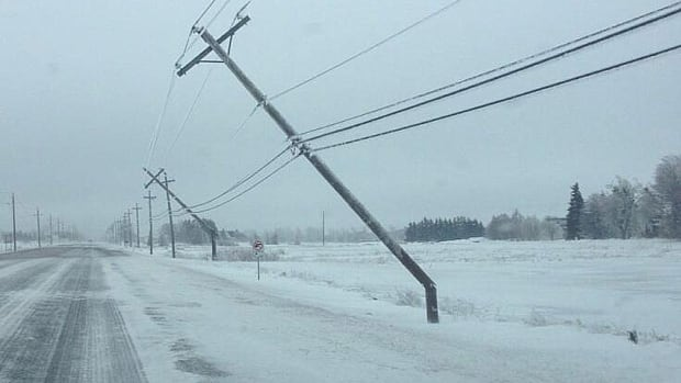 Poles came down along Highway 2 in Woodstock near O'Leary on Monday.