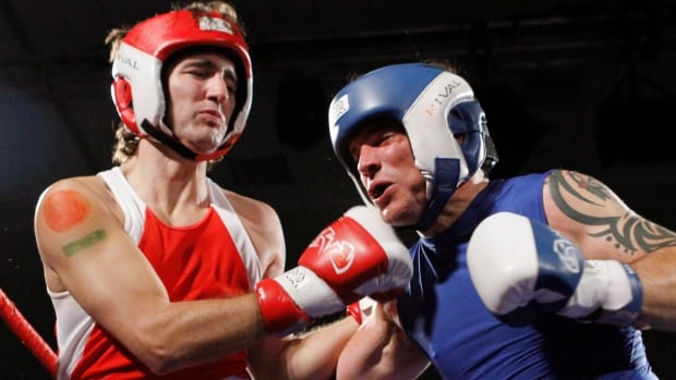 Conservative Senator Patrick Brazeau, right, and Liberal MP Justin Trudeau take part in a charity boxing match for cancer research Saturday, March 31, 2012, in Ottawa.