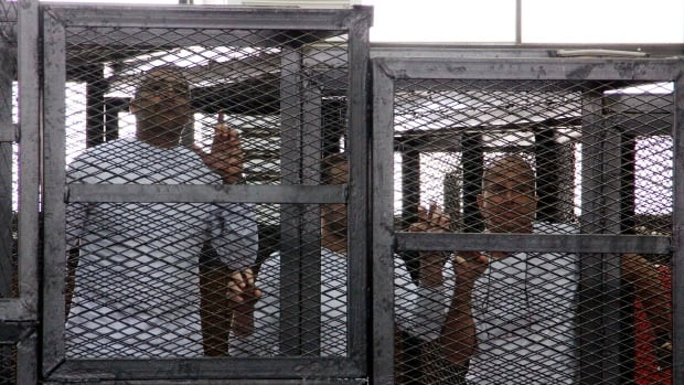 Al-Jazeera English bureau chief Mohammed Fahmy, left, producer Baher Mohamed, centre and correspondent Peter Greste, right, asked a Cairo judge to set them free.