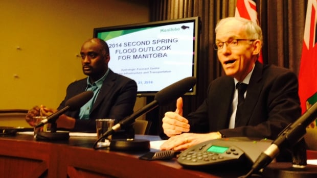 Manitoba flood forecaster Fisaha Unduche, left, and Infrastructure and Transportation Minister Steve Ashton speak to reporters on Monday about the second flood outlook of the 2014 season.
