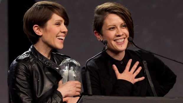 Tegan and Sara celebrate their Juno Award for Pop Album of the year during the Juno Gala in Winnipeg on Saturday.