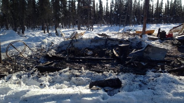 One person is dead and another injured after an over-packed stove caused a cabin to catch fire about 16 kilometres outside of Inuvik, N.W.T.