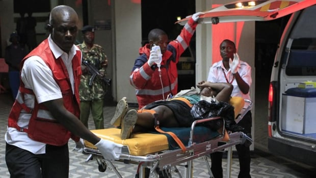 An injured blast victim arrives in an ambulance at Kenyatta National Hospital in Nairobi March 31, 2014. Ab explosion, in an area of Kenya's capital Nairobi that is popular with Somalis, killed six people and wounded several others on Monday, the National Disaster Operations Centre said.