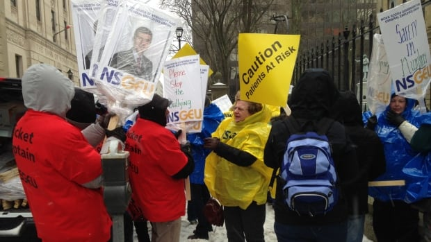 Nurses with the Capital District Health Authority, who began an illegal strike on Tuesday, prepare to picket outside Province House in Halifax.