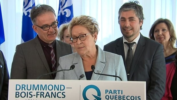 Parti Québécois Leader Pauline Marois responds to allegations circling her husband, Claude Blanchet, during a campaign stop in Drummondville.