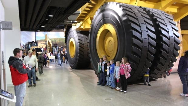 Visitors look at equipment at the Caterpillar Visitors Center in Peoria, Ill. The company has come under scrutiny by a Senate committee because of its practice of shifting profits to Switzerland to avoid U.S. taxes.