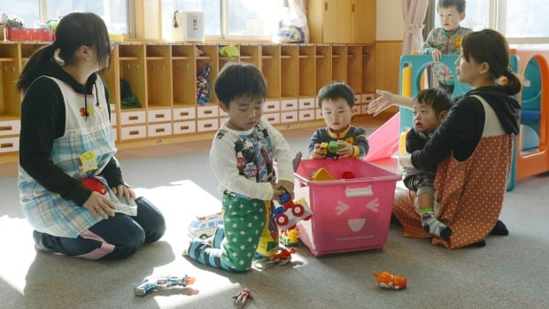 Toddlers play at a nursery school in Tamura, a city that's among the first areas of the Fukushima region to be resettled after the nuclear disaster there three years ago.