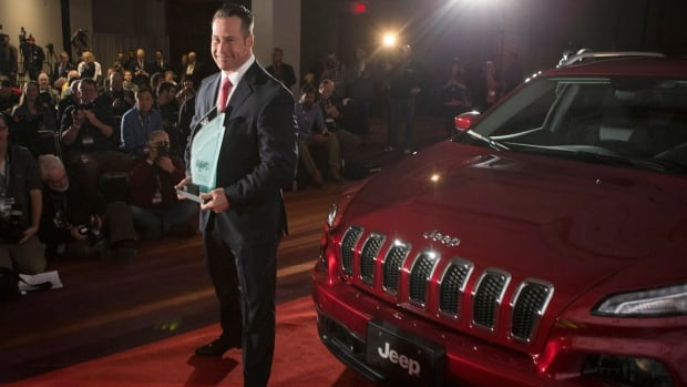 Chrysler Canada's Reid Bigland poses  with a plaque as the Jeep Cherokee is unveiled as the Canadian utility  car of the year at the Canadian International Auto Show in Toronto Feb. 13. Chrysler sales in Canada rose by 2 per cent in March.