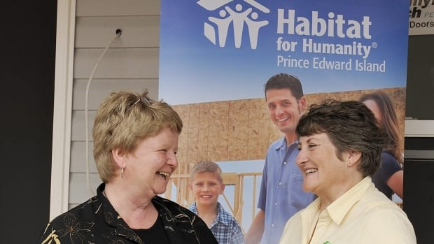 Minister of National Revenue Gail Shea, left, in Charlottetown last June promoting the Harper government's new first-time donor's 'super credit' for charitable donations with Susan Zambonin, executive director of Habitat for Humanity P.E.I.