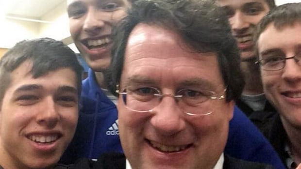 Parti Québécois candidate Bernard Drainville snaps a selfie with a group of students at CEGEP Lionel-Groulx.