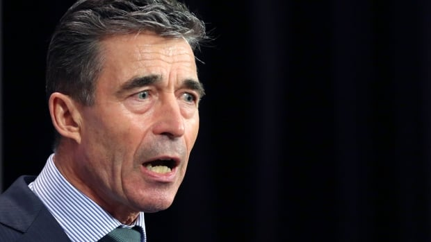 "NATO Secretary General Anders Fogh Rasmussen addresses a news conference during a NATO foreign ministers meeting at the Alliance headquarters in Brussels. He said Wednesday Russia would make a ""historic mistake"" with any further incursion into Ukraine."