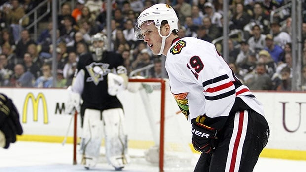 Chicago captain Jonathan Toews skates off the ice after being checked into the boards by Pittsburgh's Brooks Orpik on Sunday.