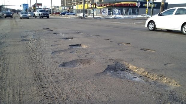 Deep potholes can be seen on St. James Street, near Ness Avenue in Winnipeg, just as CAA Manitoba launched its annual worst roads campaign in March of 2014.