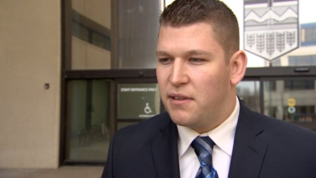 Adam Kube spoke to reporters outside the Edmonton courthouse on Wednesday after pleading guilty to a lesser charge of obstructing a peace officer.