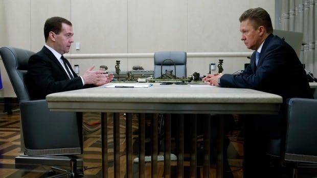Russian Prime Minister Dmitry Medvedev, left, meets with Gazprom's chief executive Alexei Miller in Moscow, Russia, on Thursday ahead of an announcement that Gazprom will hike gas prices to Ukraine by 70 per cent.