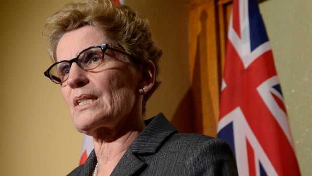 Ontario Premier Kathleen Wynne has distanced herself from her predecessor, former premier Dalton McGuinty, following police allegations one of his staffers may have committed breach of trust.