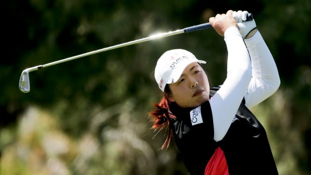 Shanshan Feng of China, watches her tee shot on the 17th hole during the first round at the Kraft Nabisco Championship golf tournament on Thursday.