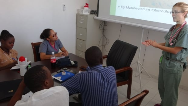 Haitian medical residents ask questions and get engaged during a seminar with pediatrician Natalie Bridger.