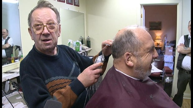 Norbert May, known as Bert the barber in Happy Valley-Goose Bay, cuts hair in his shop on Bert's Loop, which was named after him this week.