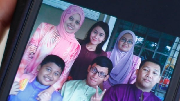 Among the passengers on the missing Malaysia Airlines plane are Muhammad Razahan Zamani, far right, and his new wife, Norli Akmar Hamid, second from right, who were headed to Beijing for their honeymoon.