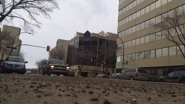 Following the snow melt Saskatoon's streets are covered in sand.