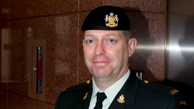 Reservist Darryl Watts arrives at court in Calgary Friday to appeal his military court martial conviction and demotion from major to lieutenant.